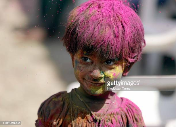 Children play with colours and water as they celebrate Holi festival on March 20 2019 in Pune India Holi Festival also known as Spring Festival of...