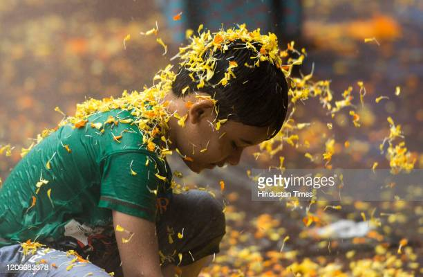 Children play with colours and water as they celebrate Holi festival at Andheri on March 10 2020 in Mumbai India