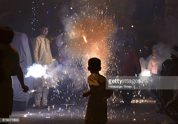 Children play with fire crackers while celebrating the Hindu festival of Diwali the annual festival of lights and heavy air pollution on October 30...