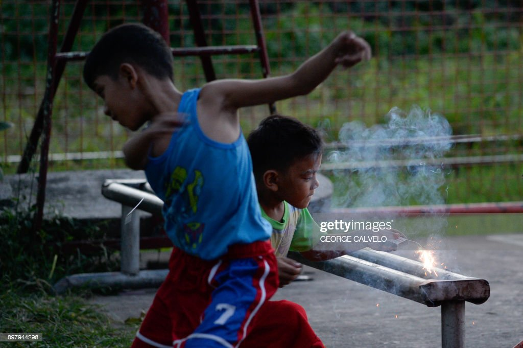 Topshot Children Play With Firecrackers On Christmas Eve