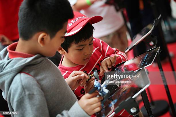 Children play with iPads and the apptivity app at Westfield shopping Centre on August 21 2012 in London England The new app from toy maker Mattel...