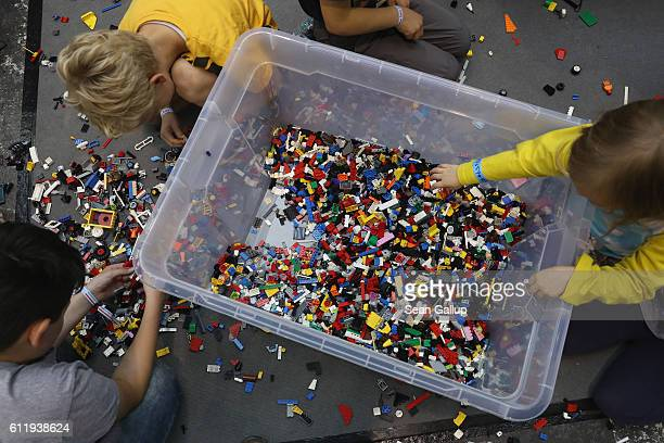 Children play with Legos at the 2016 Berlin Maker Faire on October 1 2016 in Berlin Germany The Maker Faire combines a trade fair with handson...