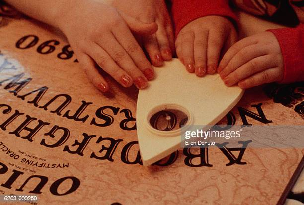 Children Play with Ouija Board