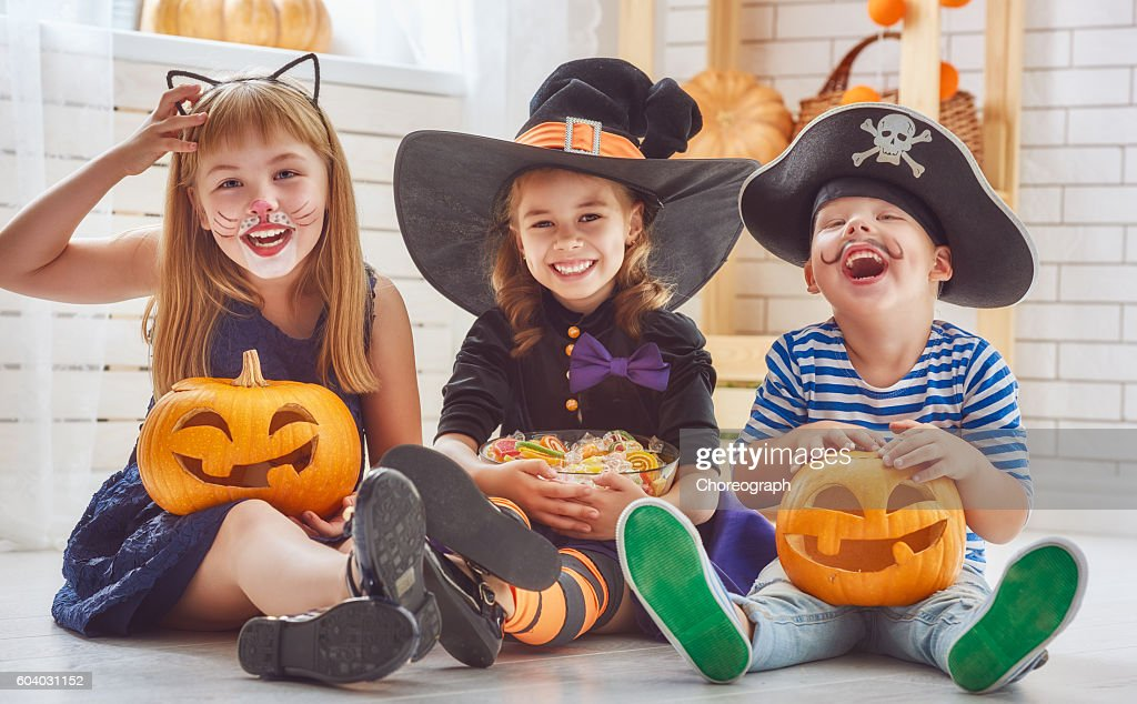 children play with pumpkins : Stock Photo
