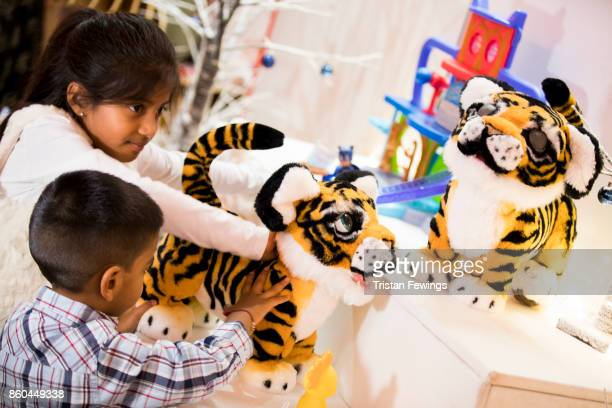 Children play with Tyler the Playful Tiger FurReal Buzz Pets as Hamley's announce it's top ten toys for Christmas at Hamleys on October 12 2017 in...