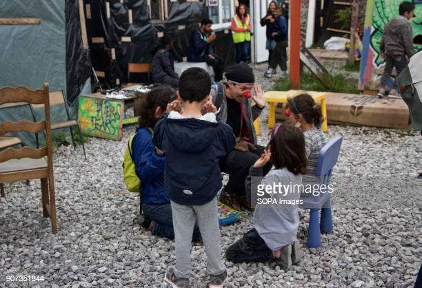 Children play with volunteers in the camp in Calais where thousands were living in the hopes of getting to the UK before it was demolished The Calais...