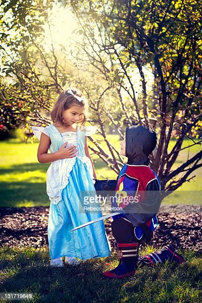 Children playacting knight and princess