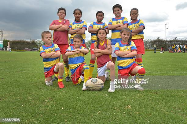 Children players of the Fundacion Colombianitos of Cuidad Bolivar pose during the Bob Hosty Youth Rugby Cup in Bogota Colombia on October 26 2014 AFP...