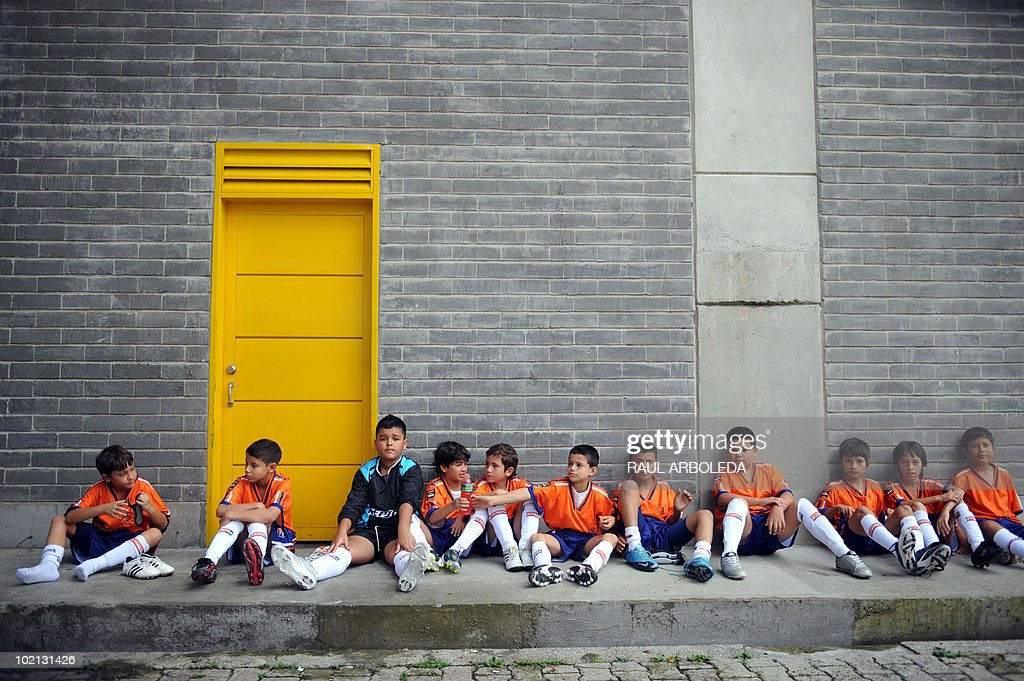 Children players rest during the 'Mundialito' football tournament in Medellin, Antioquia department, Colombia on June 15, 2010. The 'Mundialito' tournament takes place every four years with the participation of Medellin soccer schools. AFP PHOTO/Raul ARBOLEDA