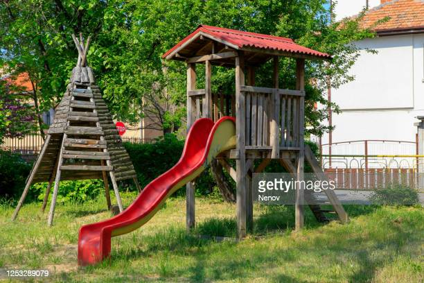 children playground in the city park - slide play equipment stock pictures, royalty-free photos & images
