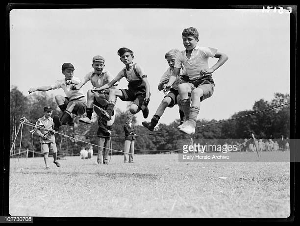 Children playing 1935 A photograph of five boys jumping over a rope taken by Tomlin for the Daily Herald newspaper on 21 August 1935 Children play at...