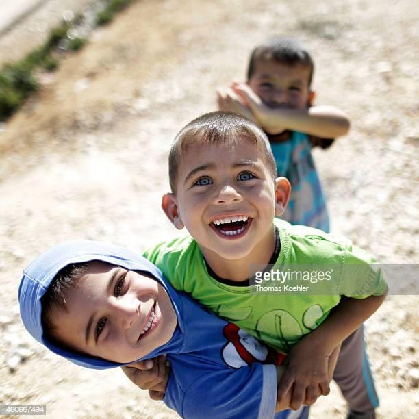 Children playing around at Zaatari refugee camp located 10 km East of Mafrag on December 10 2014 in Zaatari Jordan The camp population is estimated...