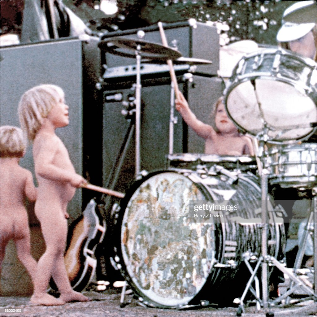 Children playing around with a drum set on the Woodstock stage at the Woodstock Music and Arts Fair in Bethel, New York, August 15 - 17 (and part of the 18th), 1969.