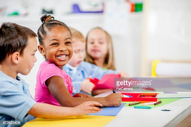 children playing at daycare - preschool stock pictures, royalty-free photos & images