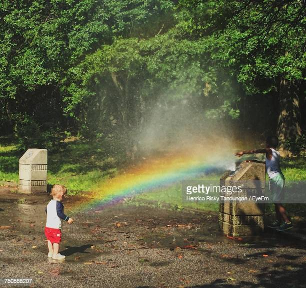 Children Playing At Drinking Fountain