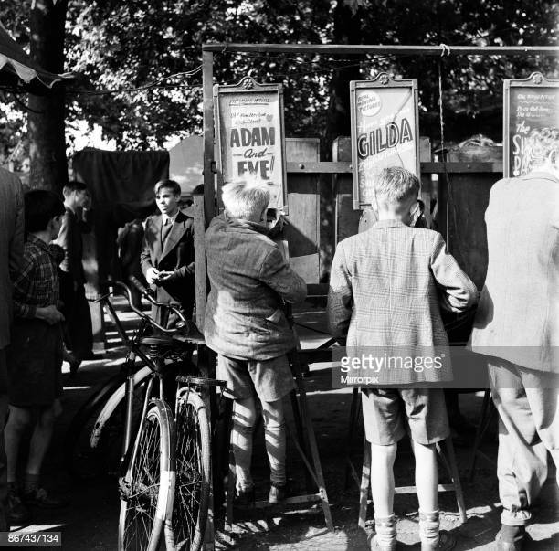 Children playing at the funfair at Roundwood Park Willesden London August 1952
