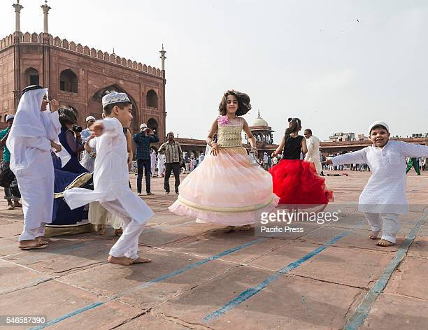 Children playing at the historic Jama Masjid lawn near Red Fort in New Delhi after the Eid-ul-Fitr morning prayer today. Eid-ul-Fitr, popularly known...