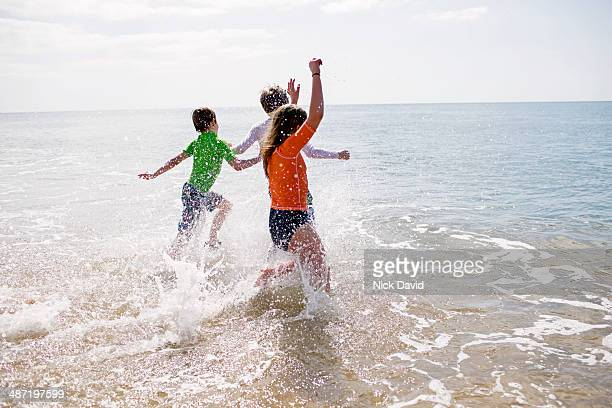 children playing at the seaside - part of stock pictures, royalty-free photos & images