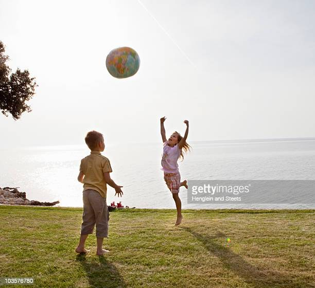 Children playing ball at the beach