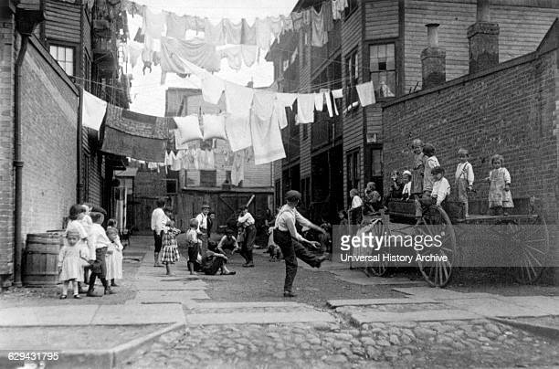 Children Playing Baseball in Tenement Alley Boston Massachusetts USA