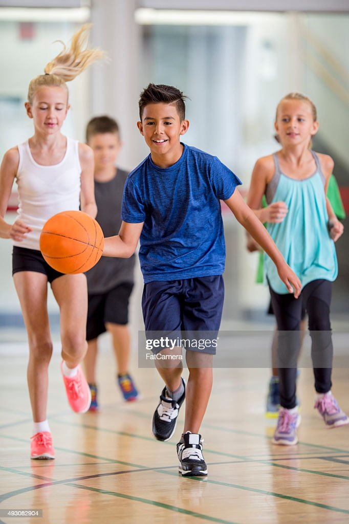 Children Playing Basketball at the Gym : Stock Photo