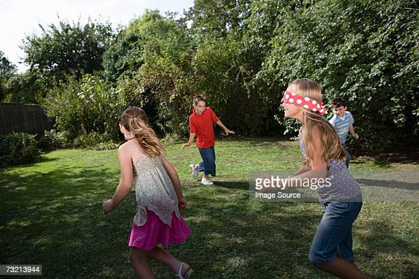Children playing blind mans bluff