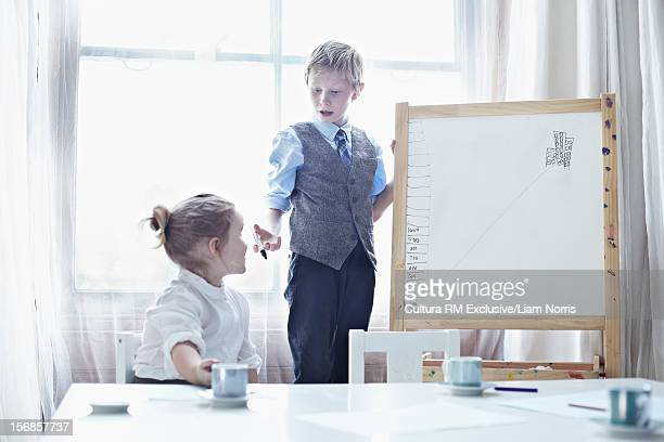 Children playing business meeting