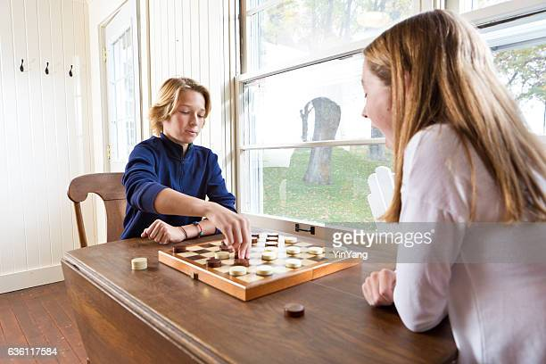 Children Playing Checker Game in Their Home