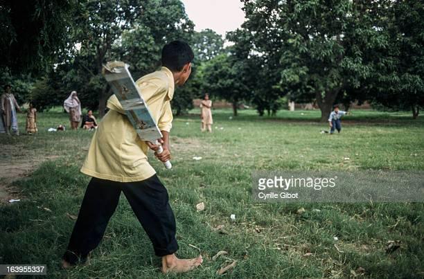 Children playing cricket in a public garden, Lahore, Punjab, Pakistan