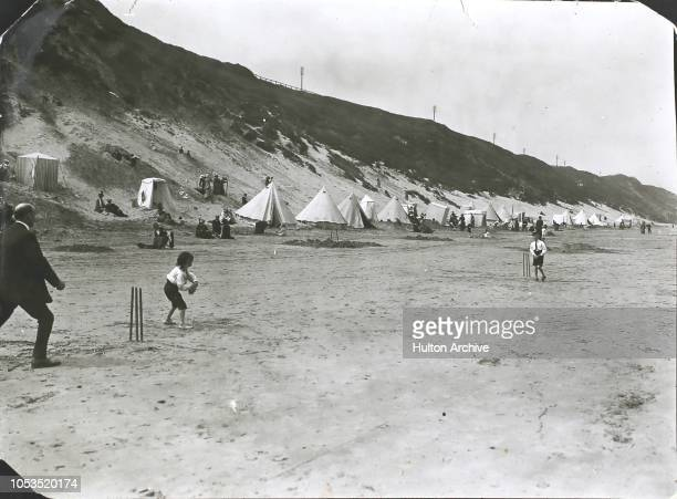 Children playing cricket on the beach at Saltburn near Whitby England 1913
