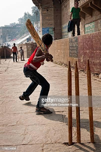 Children playing cricket on the ghats. Varanasi, Benares, Uttar Pradesh, India.2011