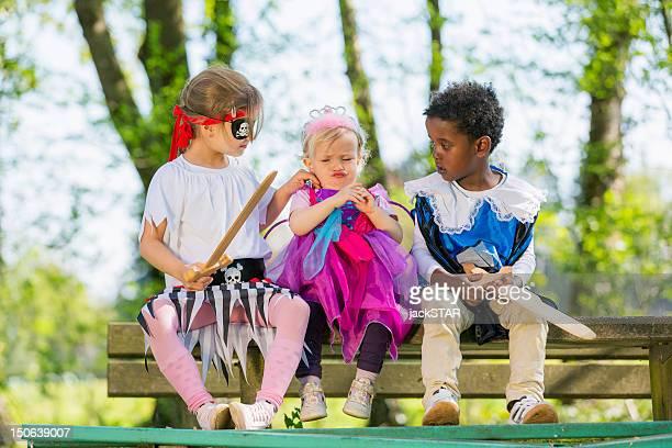 Children playing dress up outdoors