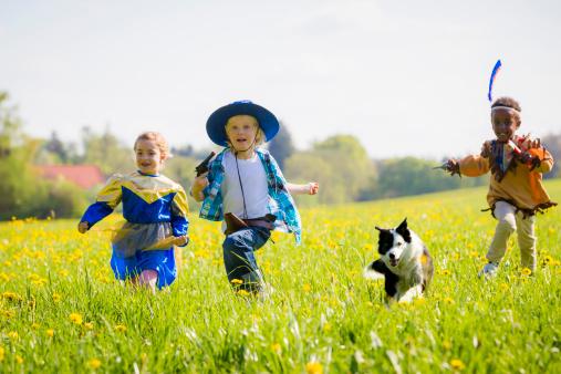 Children playing dress up outdoors - gettyimageskorea
