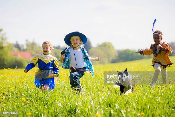 children playing dress up outdoors - royalty free images no watermark photos et images de collection