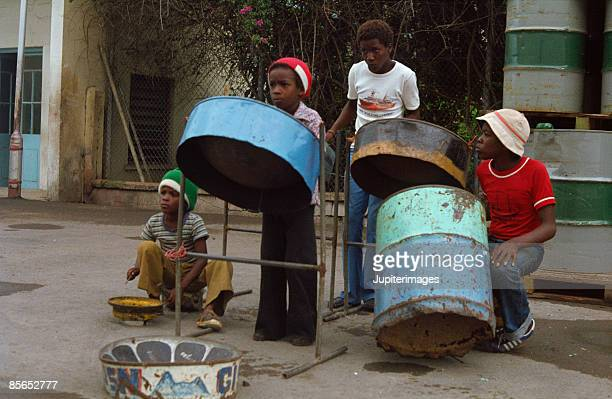 children playing drums , saint lucia , caribbean - steel drum stock photos and pictures