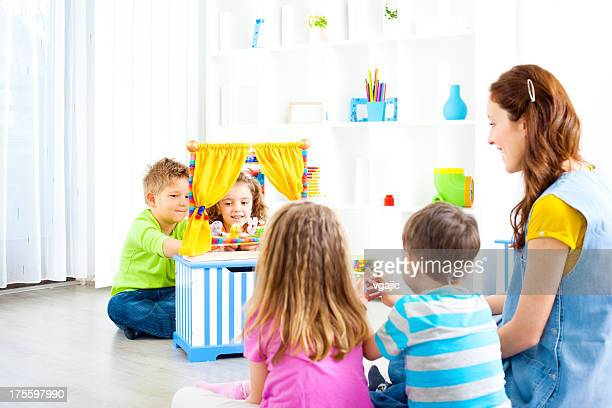 children playing finger puppet show. - puppet show stock photos and pictures