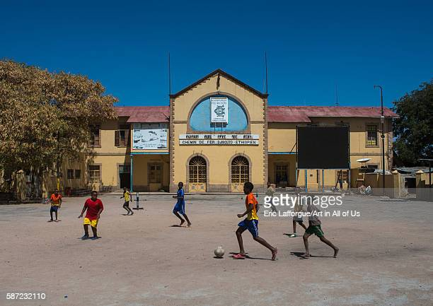 Children playing foorball in front of the ethiopia to djibouti railway station dire dawa region dire dawa Ethiopia on March 5 2016 in Dire Dawa...
