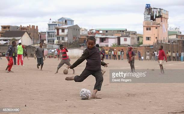 Children playing football in Antananarivo on July 21 2014 in Antananarivo Madagascar