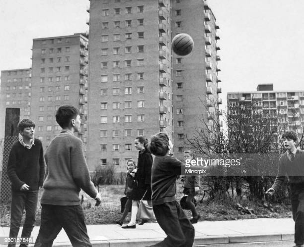 Children playing football in the street in Childwall valley housing estate, Liverpool, 10th April 1965.