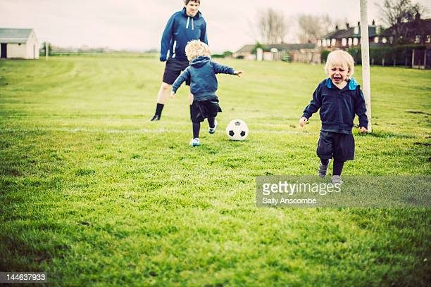 children playing football with daddy - losing virginity stock pictures, royalty-free photos & images