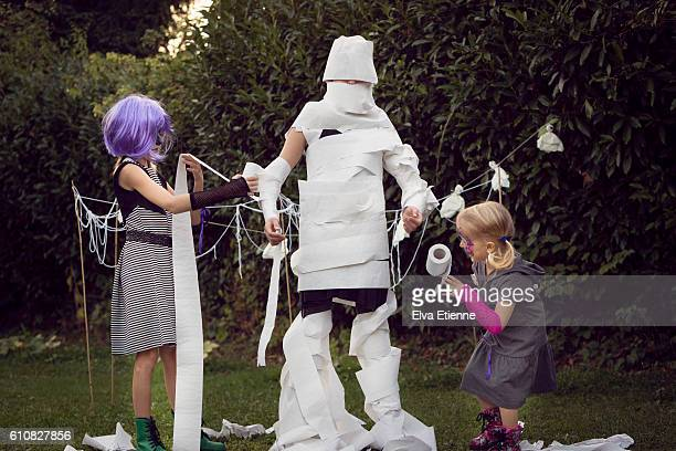 children playing halloween game - halloween kids stock photos and pictures