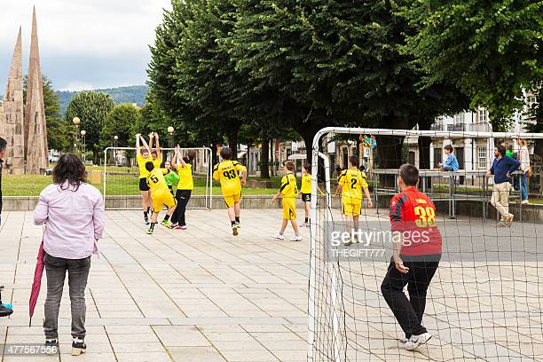 Children playing handball at the park