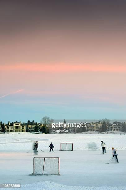 Children Playing Hockey on Pond Ice