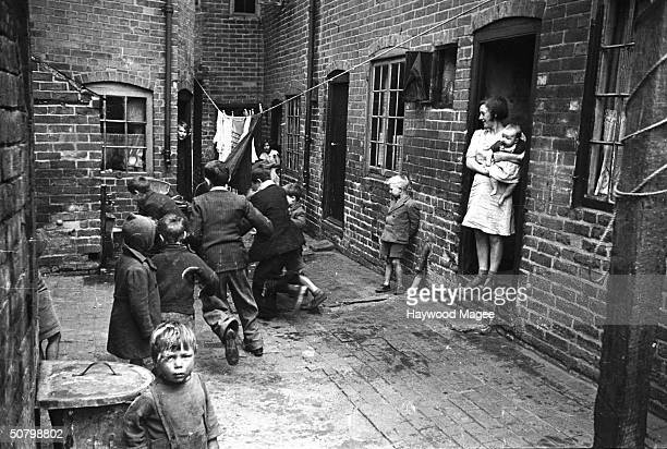 Children playing in a backyard slum in Coventry 1942