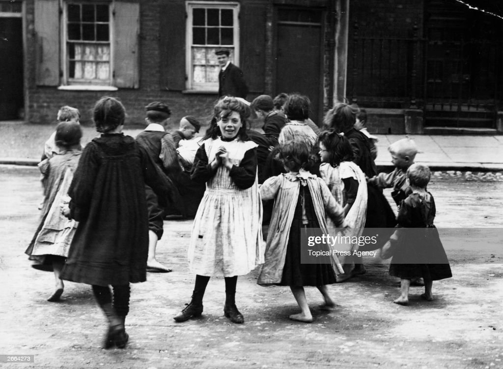 Children playing in a Belfast street after the National Union of Dockers' strike, organised by James Larkin.