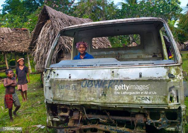 Children playing in a car wreck, Milne Bay Province, Trobriand Island, Papua New Guinea on October 4, 2009 in Trobriand Island, Papua New Guinea.