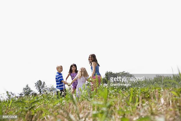 Children Playing in a Field