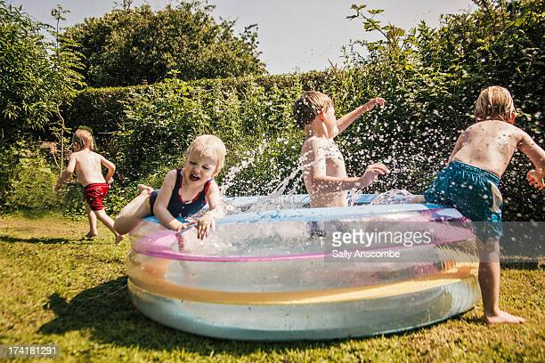 Children playing in a paddling pool