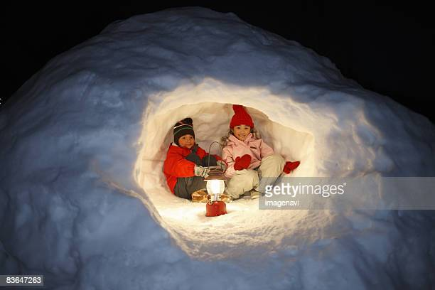 Children playing in a snow cave