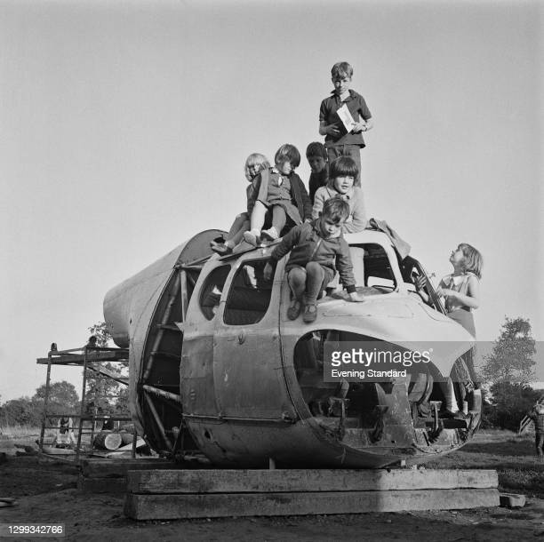 Children playing in an aircraft cockpit in Crawley New Town playground, West Sussex, UK, 19th September 1966.